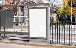 Plain white junior billboard on a bus stop in the city