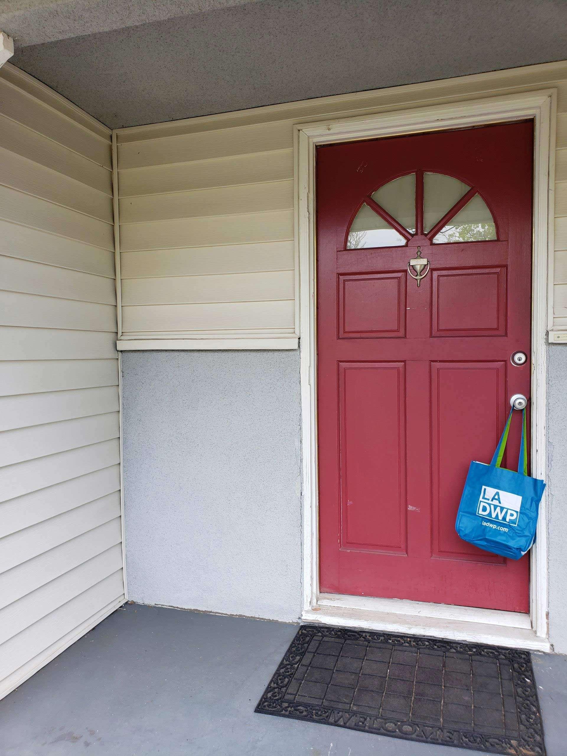 blue bag on a front door