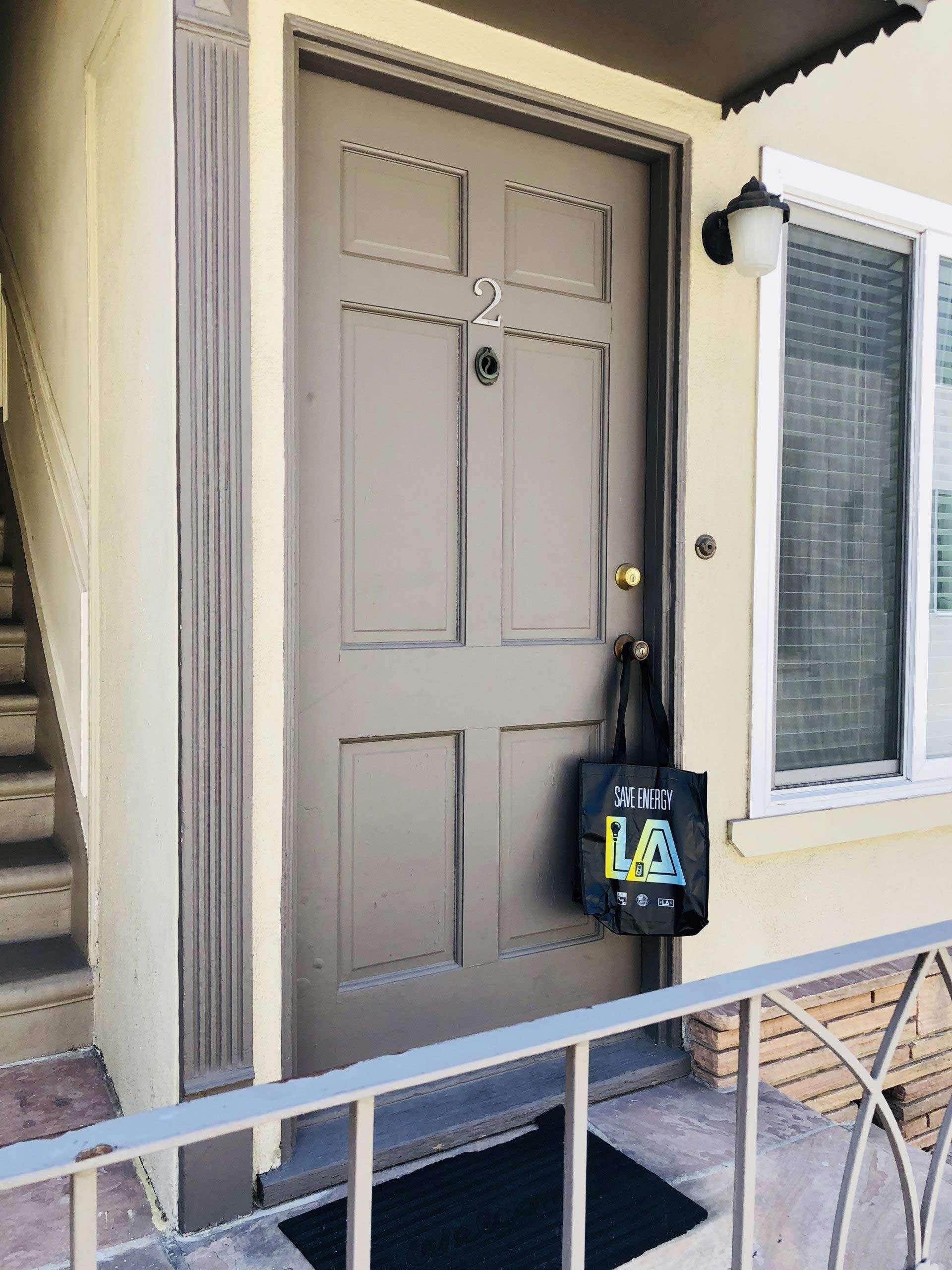 dark bag hanging on a door
