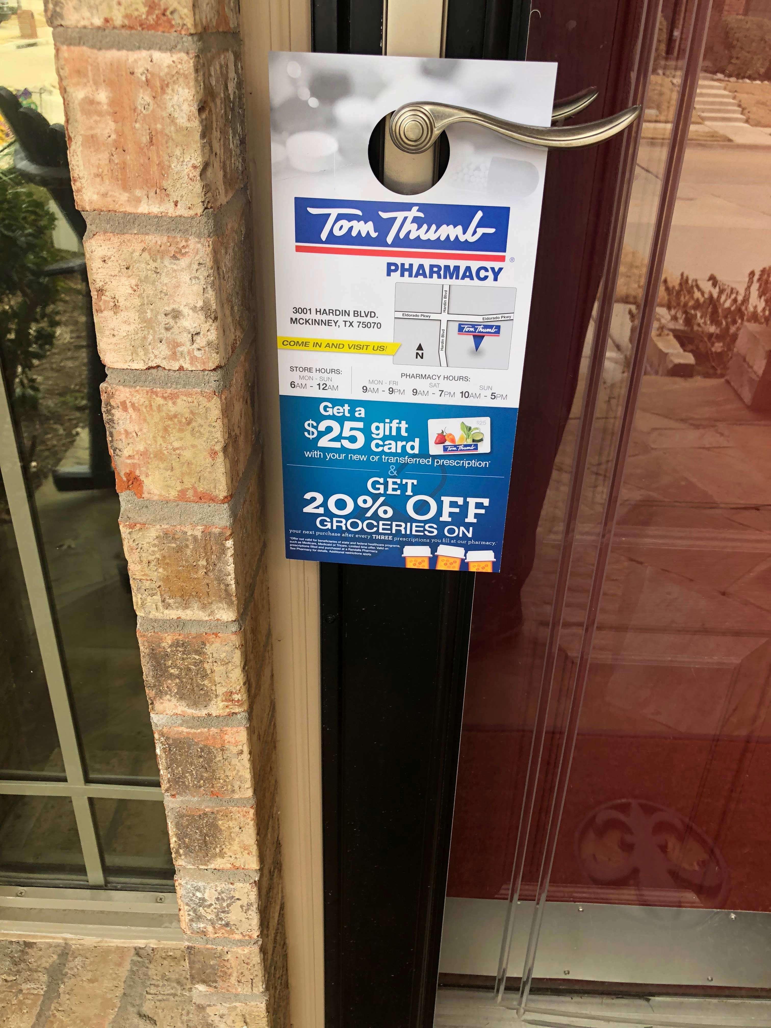 Tom Thumb Pharmacy door hanger on front door
