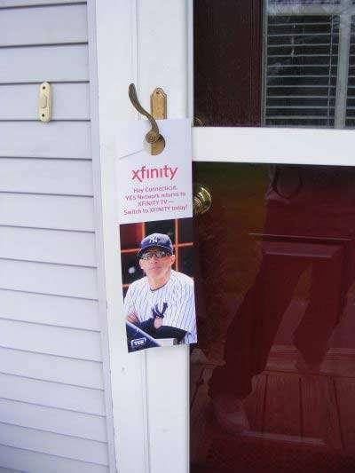 Xfinity door hanger with baseball player design