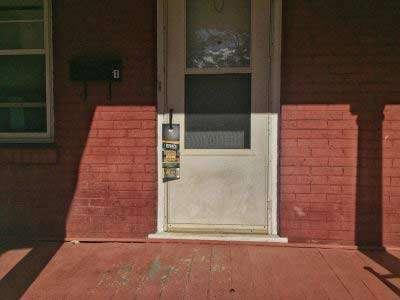 Dick's door hanger on front door