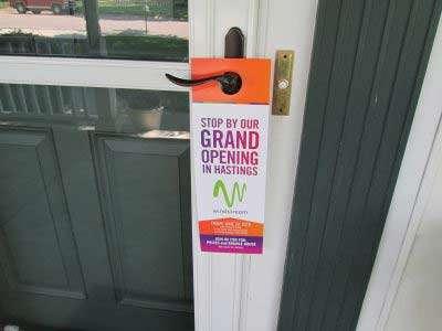 Windstream grand opening door hanger