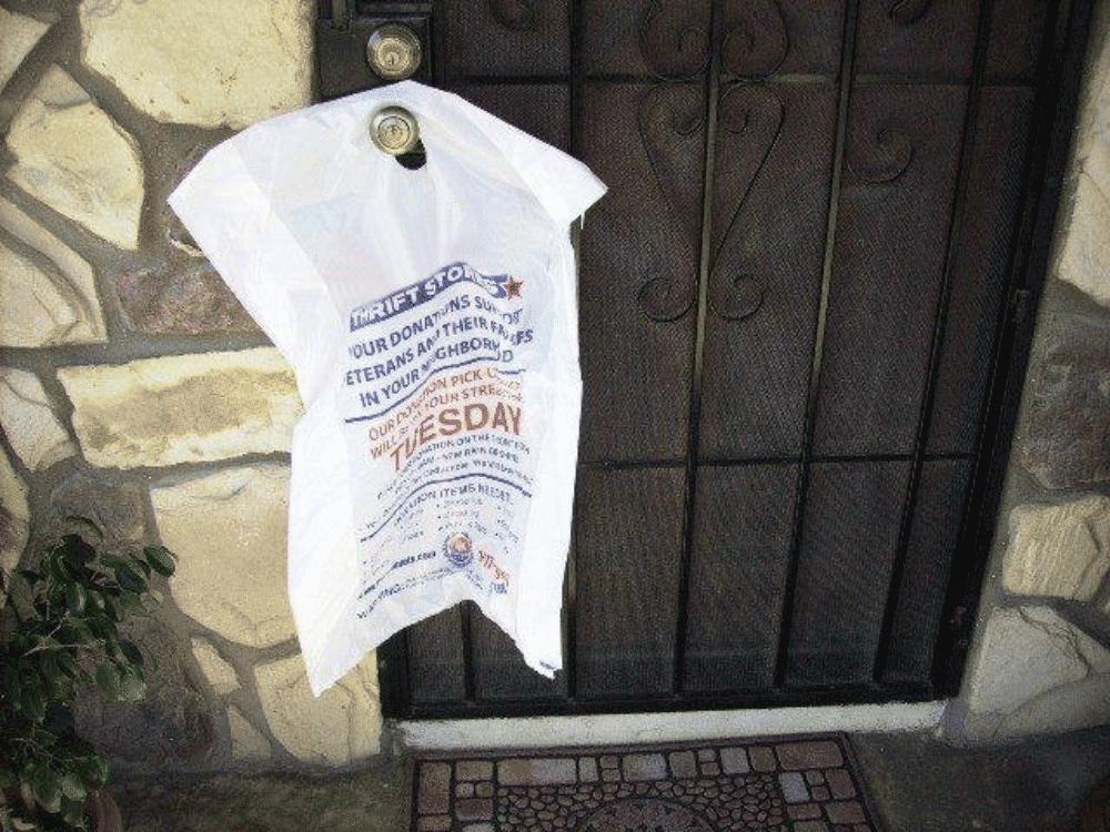 front door marketing media hanging on a door
