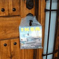 IKEA catalog hanging on front door