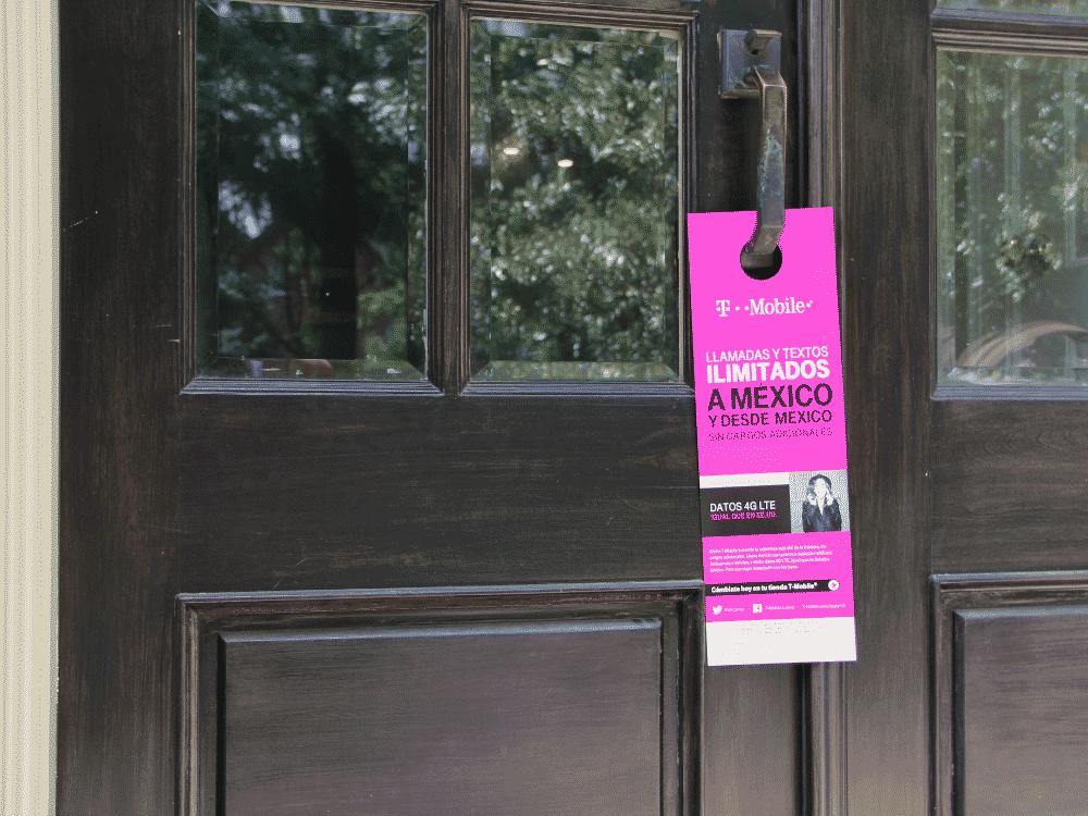 pink TMobile door hanger on a front door